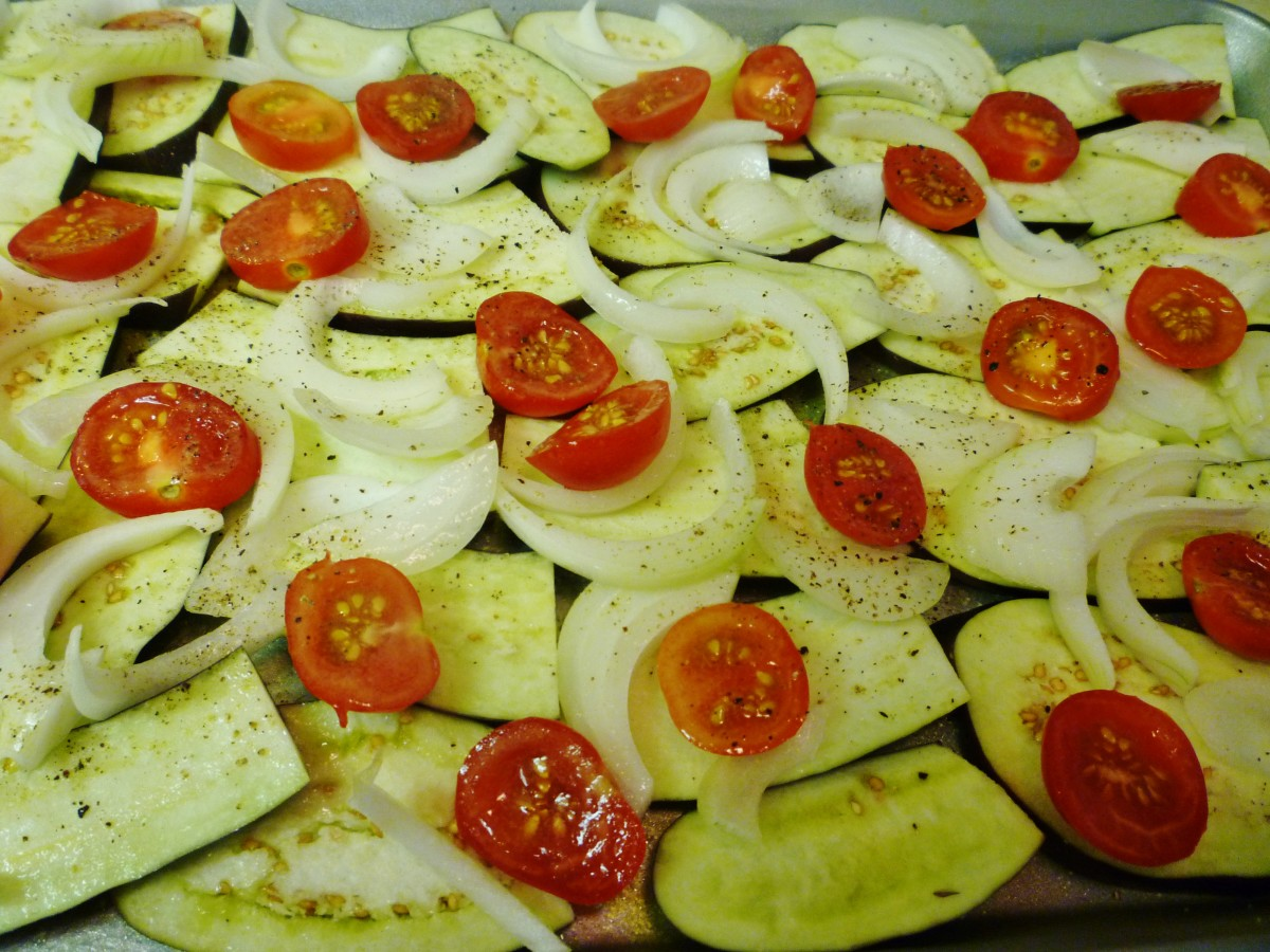 Vegetables salted & peppered and ready to be roasted in the oven.