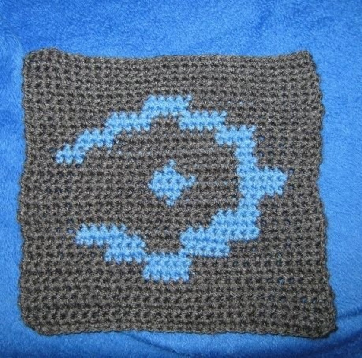 I am making a gamer's afghan (or gamerghan) for my son and this is a Halo emblem, the pattern for which I found on Ravelry