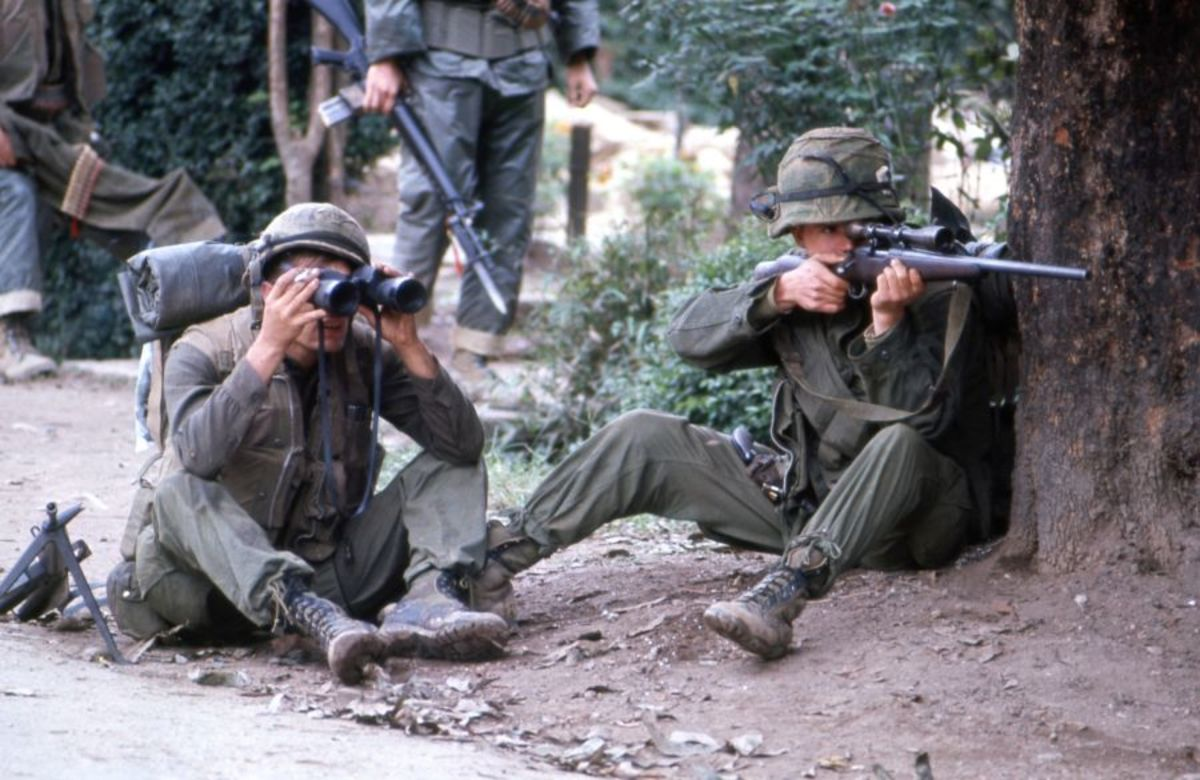 Marine sniper team searching for targets in Hue February 1968. Note in the background soldier with a bayonet on his M-16.