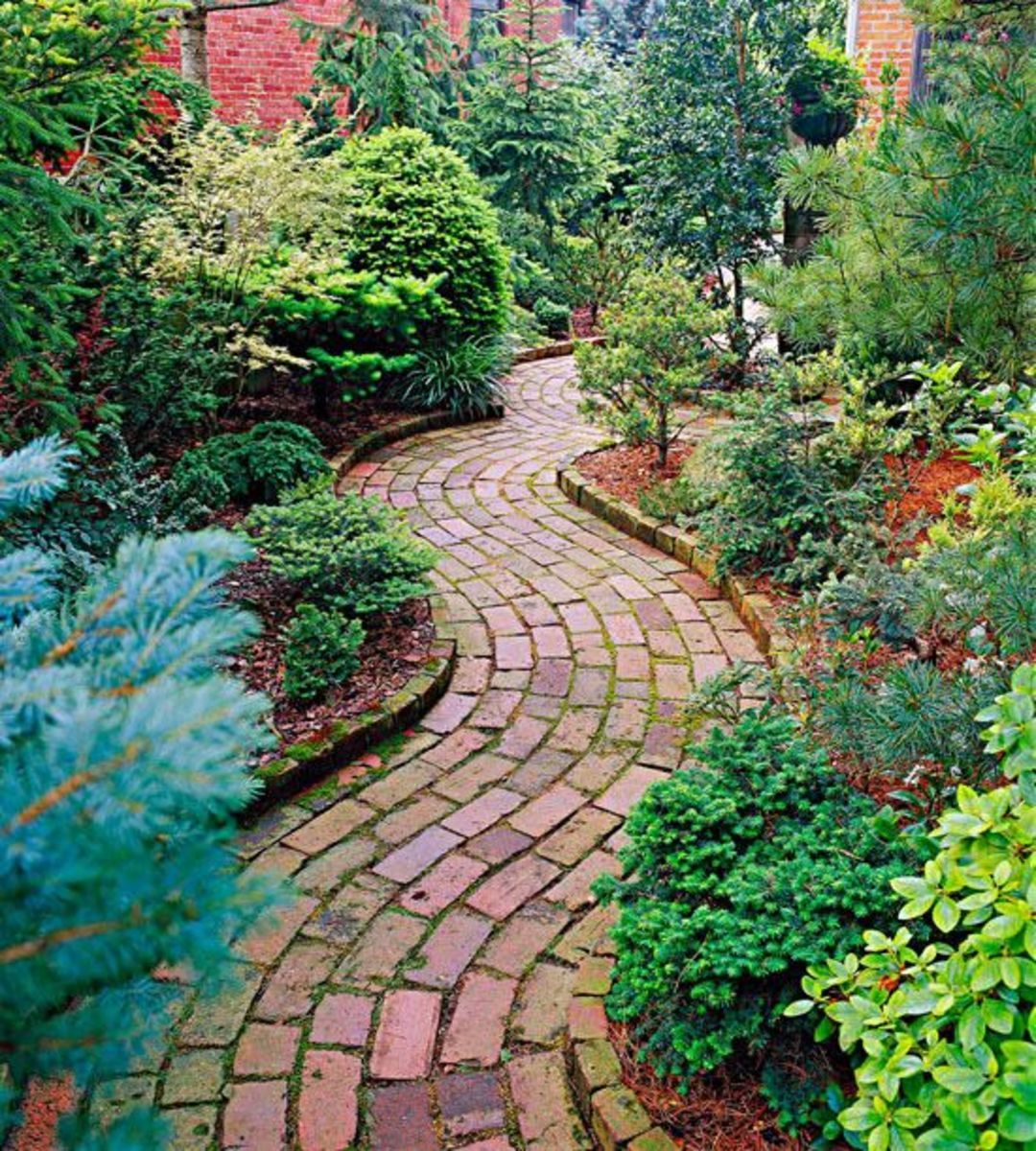 Brick pathways can help make your garden look organized and manicured. The red brick is perfect for an Aries style garden.