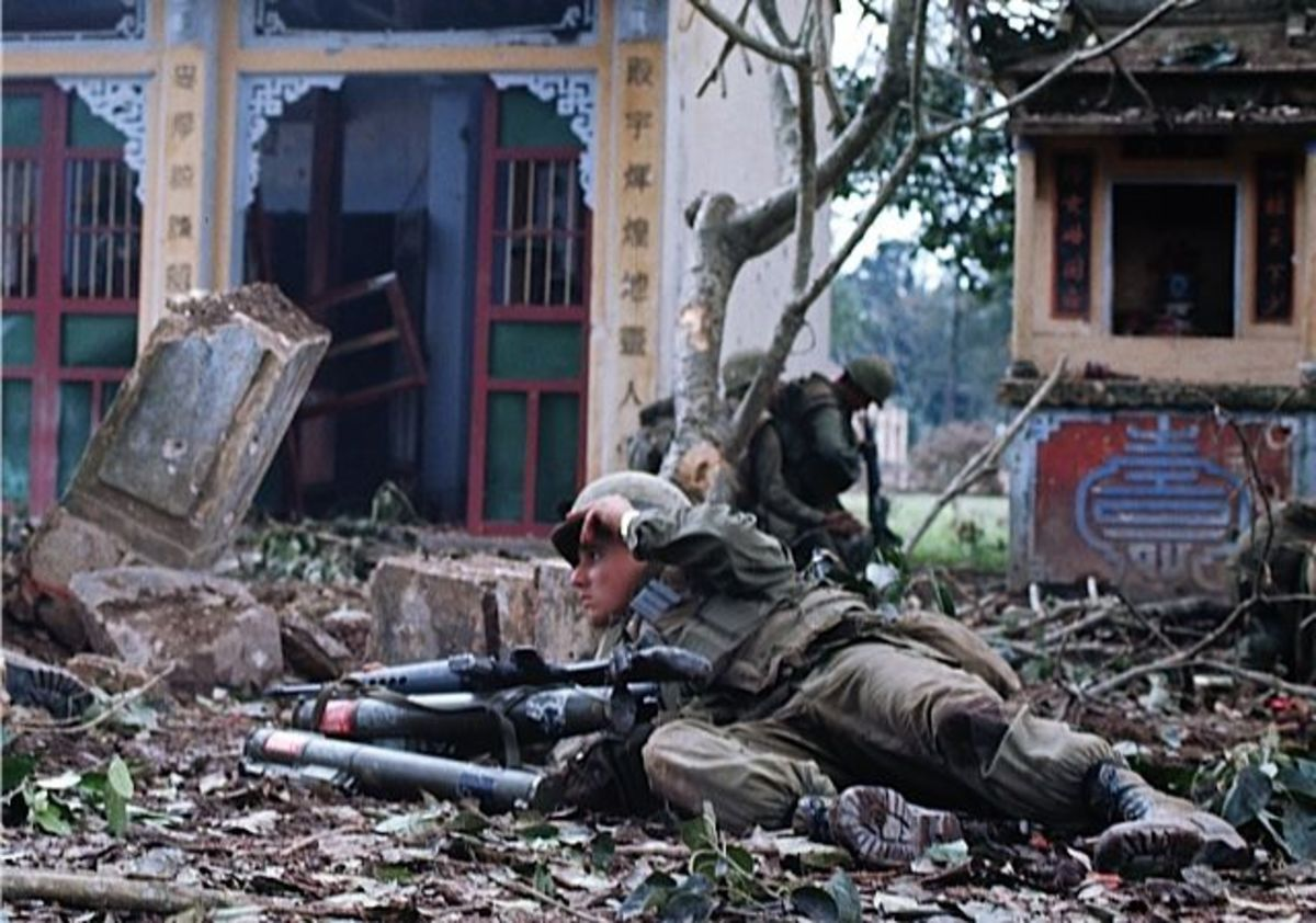 A Marine taking cover amid all the rubble by the end of the battle for Hue over 80% of  the city was destroyed.