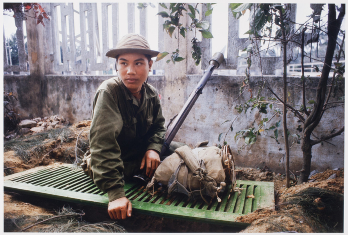 North Vietnamese soldier sitting on top of his foxhole waiting for the U.S. Marines to walk into his ambush.