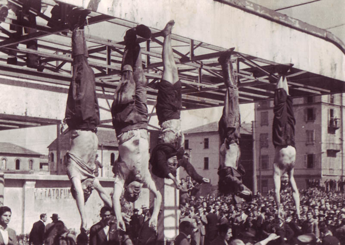 The dead body of Benito Mussolini in Milan (2nd from the left) alongside those of other Fascists.