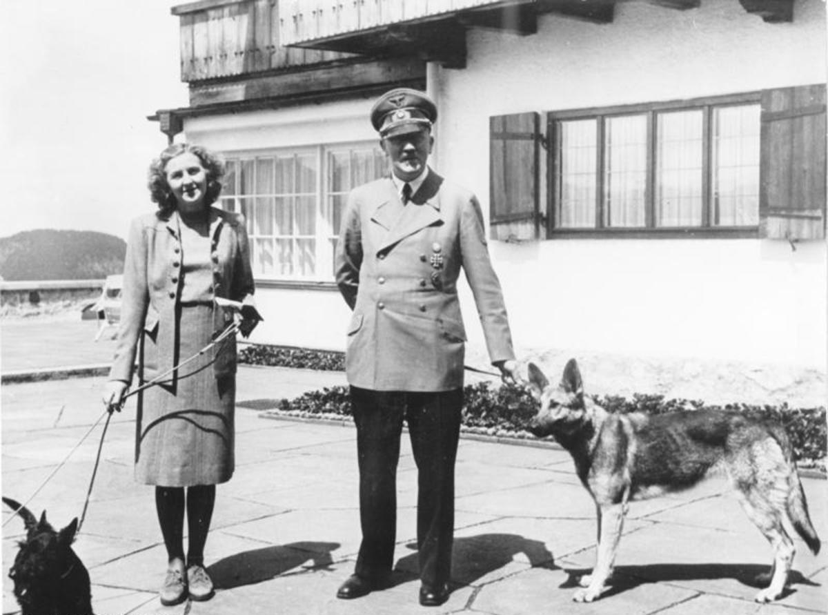Hitler and Eva Braun along with their German Shepherd Blondi in happier times.