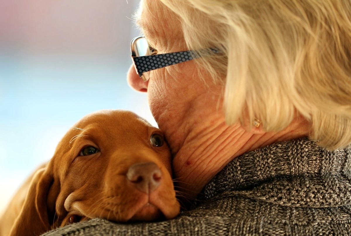 A gran and her puppy-- mutual joy!