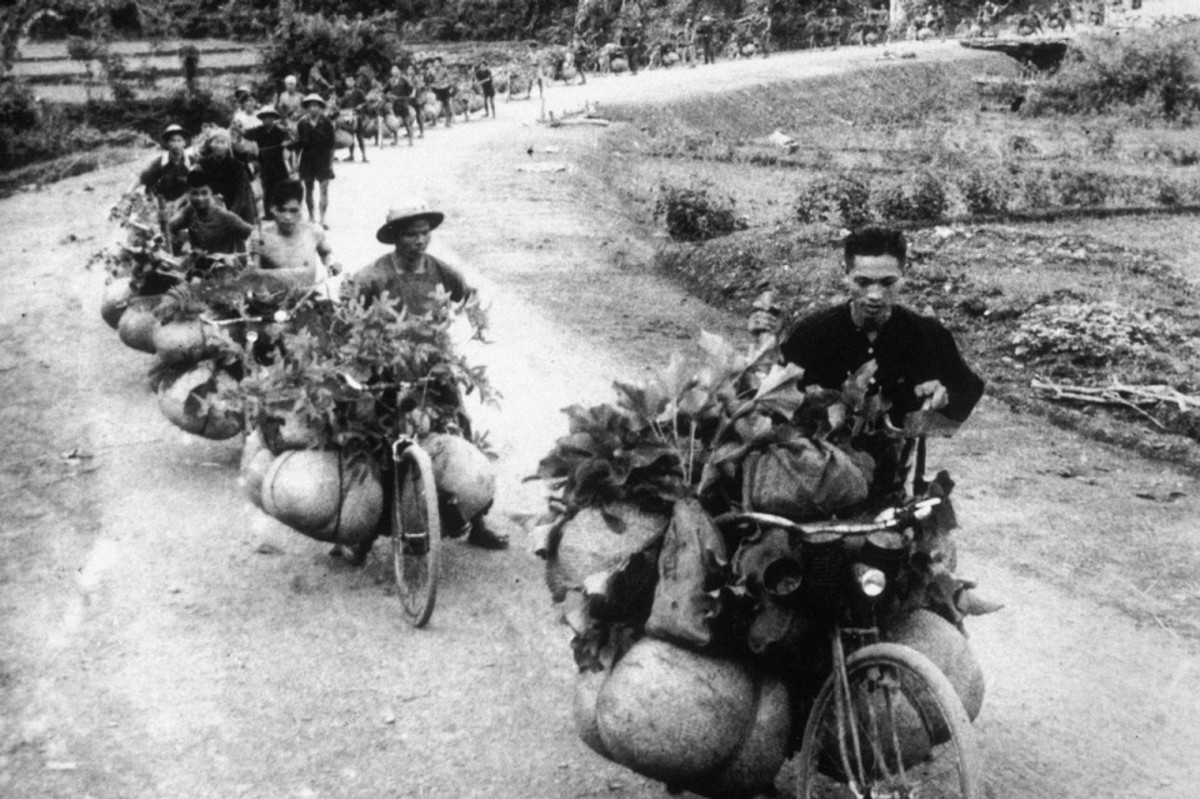Giap's troops were supplied with food and ammunition by thousands of men and women using bicycles or just their backs.