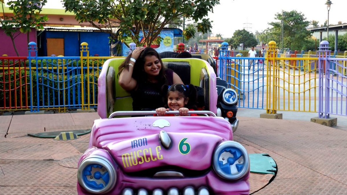 Mom and kid enjoying the ride.
