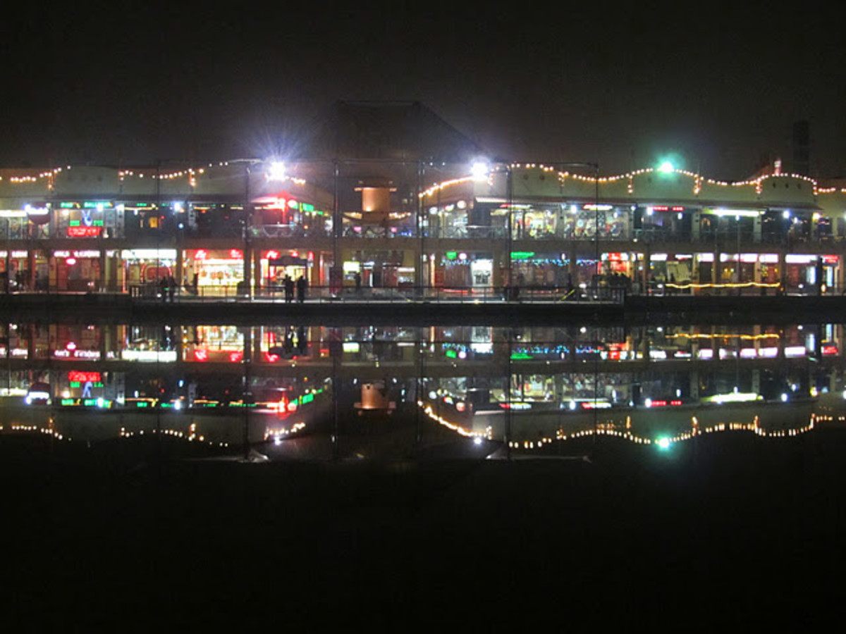 Night view of Metro Walk from Adventure Island Rohini. A beautiful lake divides adventure island with metro walk.