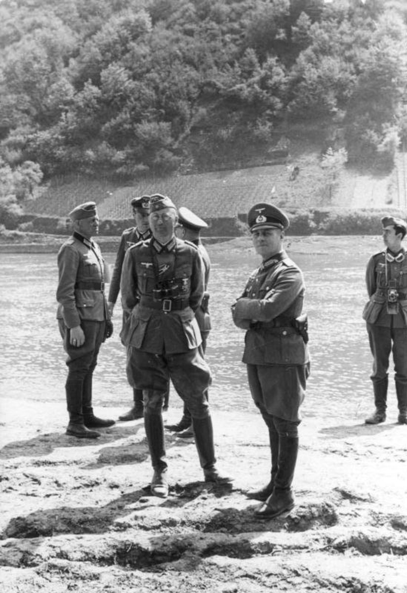 General Erwin Rommel and his staff observe troops of the 7th Panzer Division in France in 1940. His division was named he Ghost Division during the Fall of France, because it had a habit of showing up at the most unexpected places.