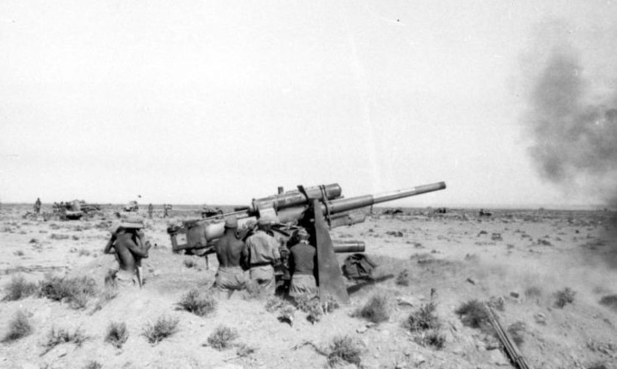 88mm Flak 18 guns fire upon British armor they would prove one of the most effective tank killers of the Second World War