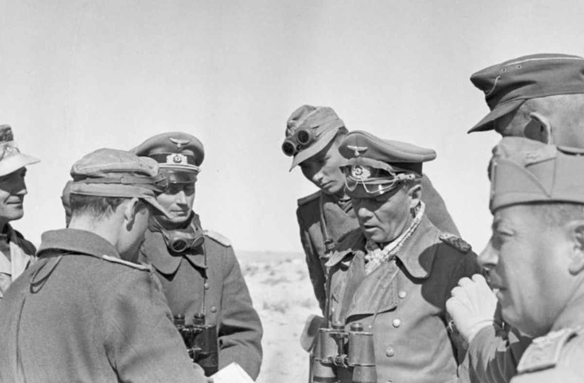 Rommel conversing with his staff near El Agheila, 12 January 1942. Soon afterward he would lead his Africa Korps on a grand march toward the Egyptian border.