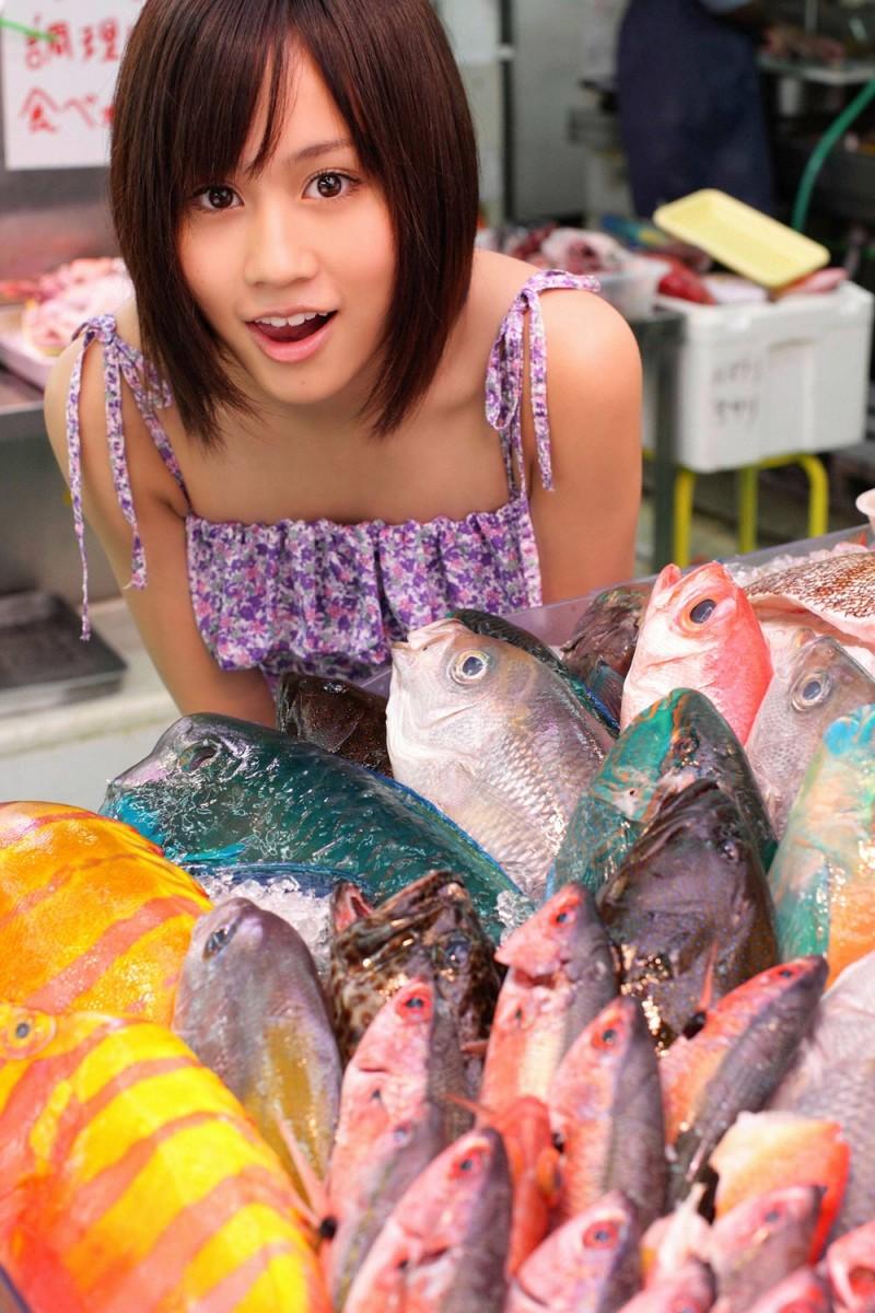 Atsuko Maeda waiting to buy some fish?