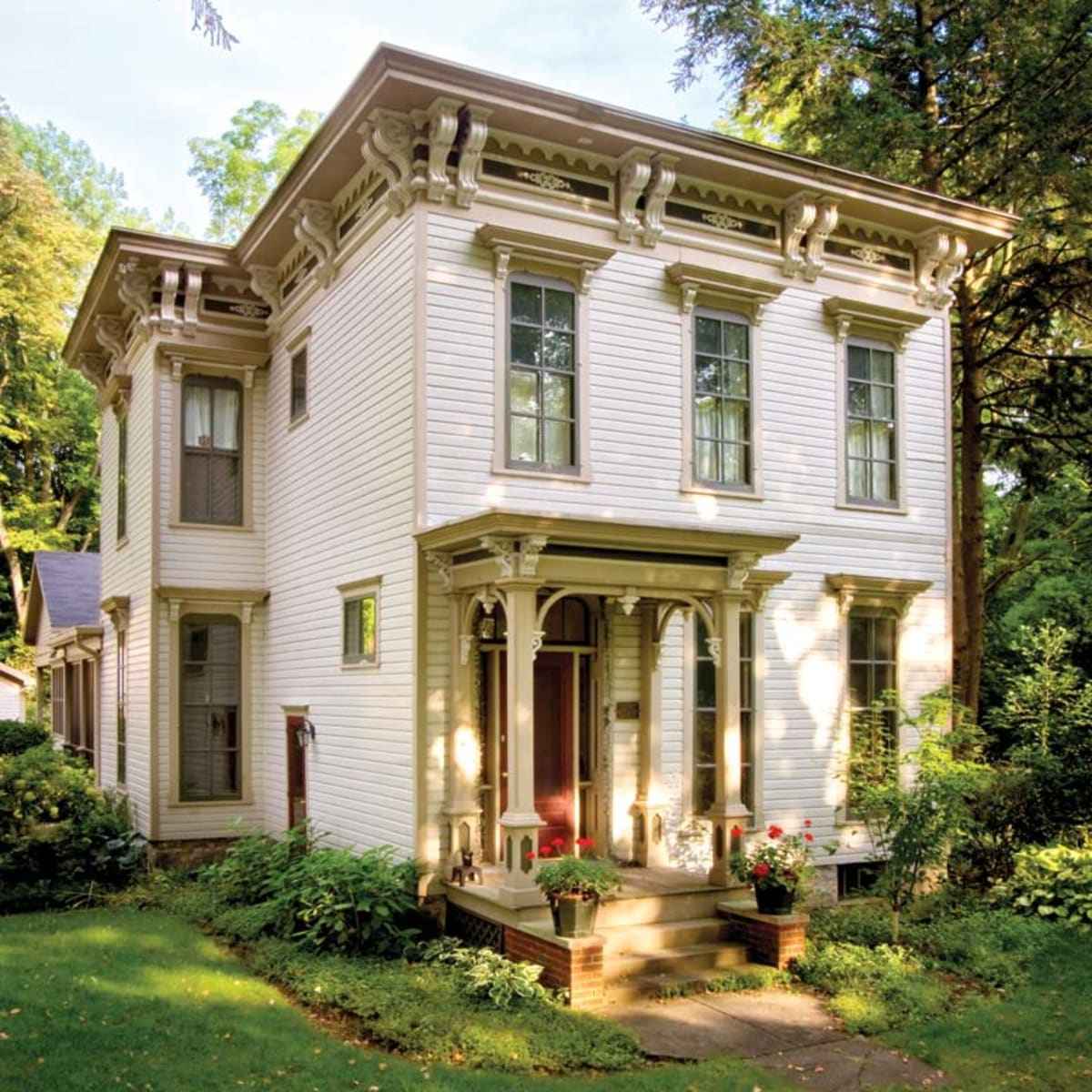 Painted in the warm earth tones typical of the period, this Michigan Italianate is  bursting with ornamentation.