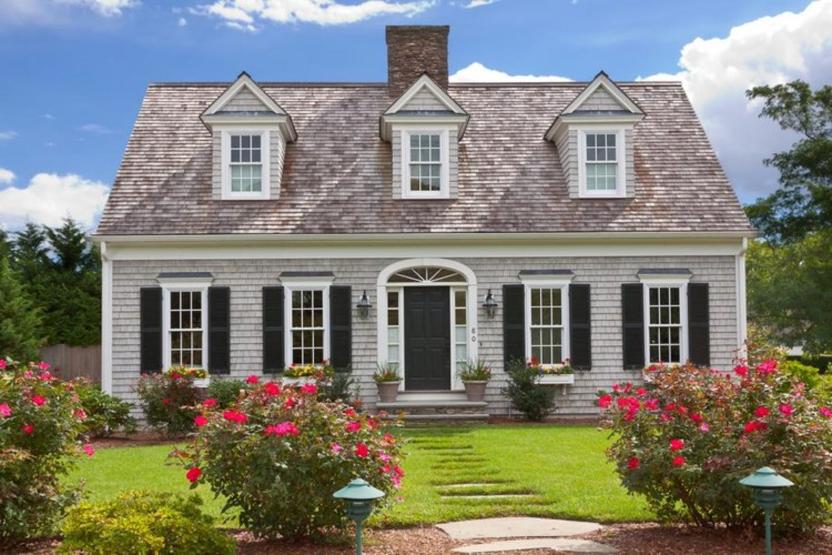 The Cape Cod is this style have a symmetrical, rectangular shape, a central chimney, dormers peeking out of a pitched roof and embellishments like shuttered windows and window boxes.