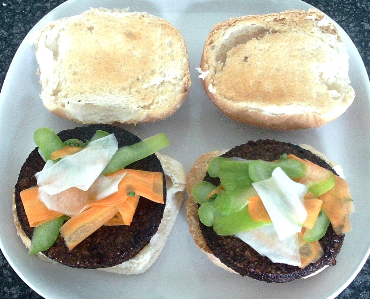 Vegan burgers with pickled white turnip, carrot and apple salad