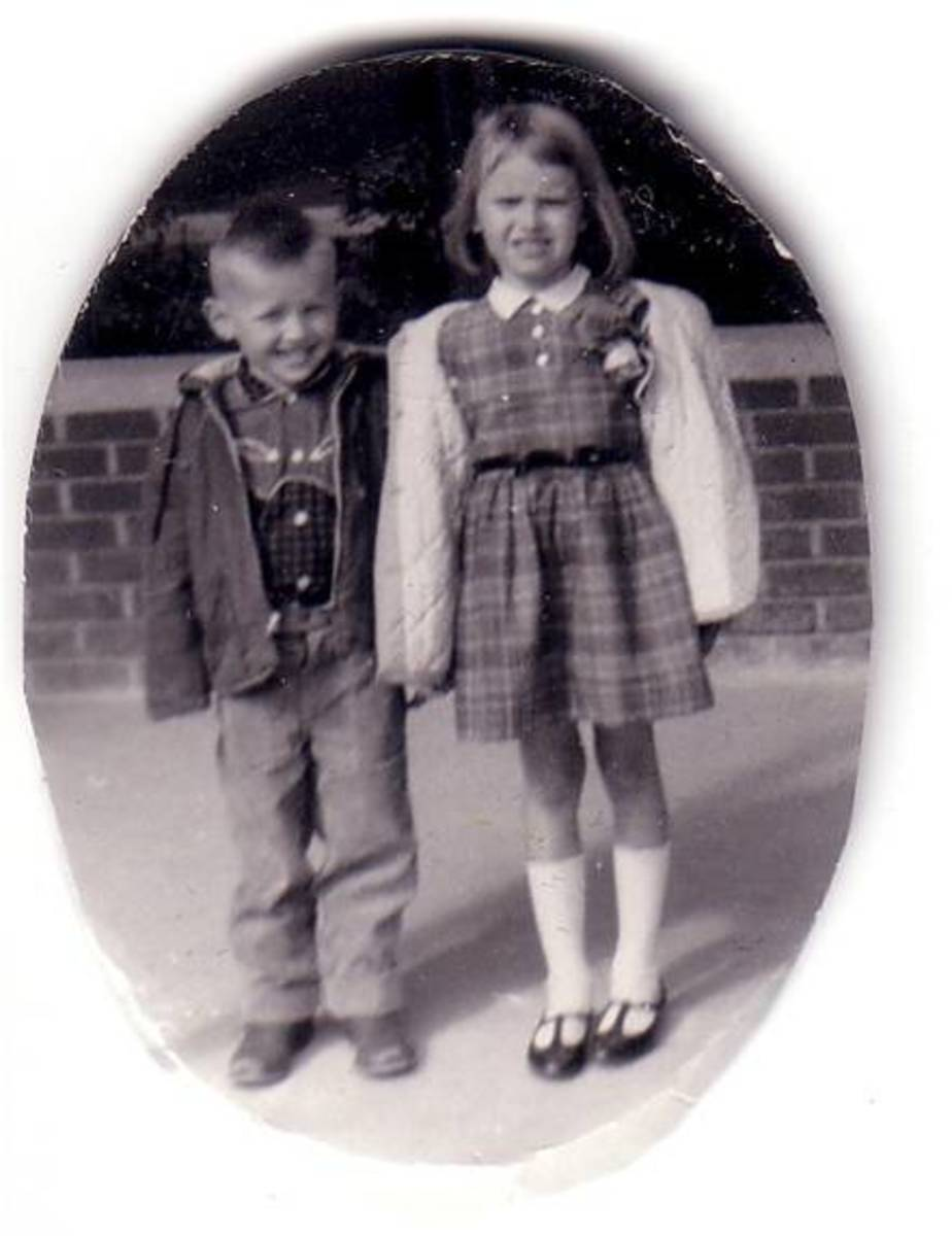 First day of school.  That's my brother, Ed, or Eddie, as we used to call him as a child, who is a year younger than I am. I don't look too happy. Apparently, my mother loved plaid dresses. Looks like I am wearing a drooping rose corsage ...