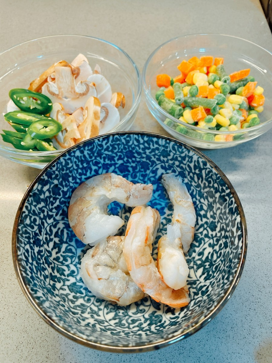 If you don't like shrimp, you can substitute chicken. I use frozen mixed vegetables. I also add sliced mushroom and serrano peppers.