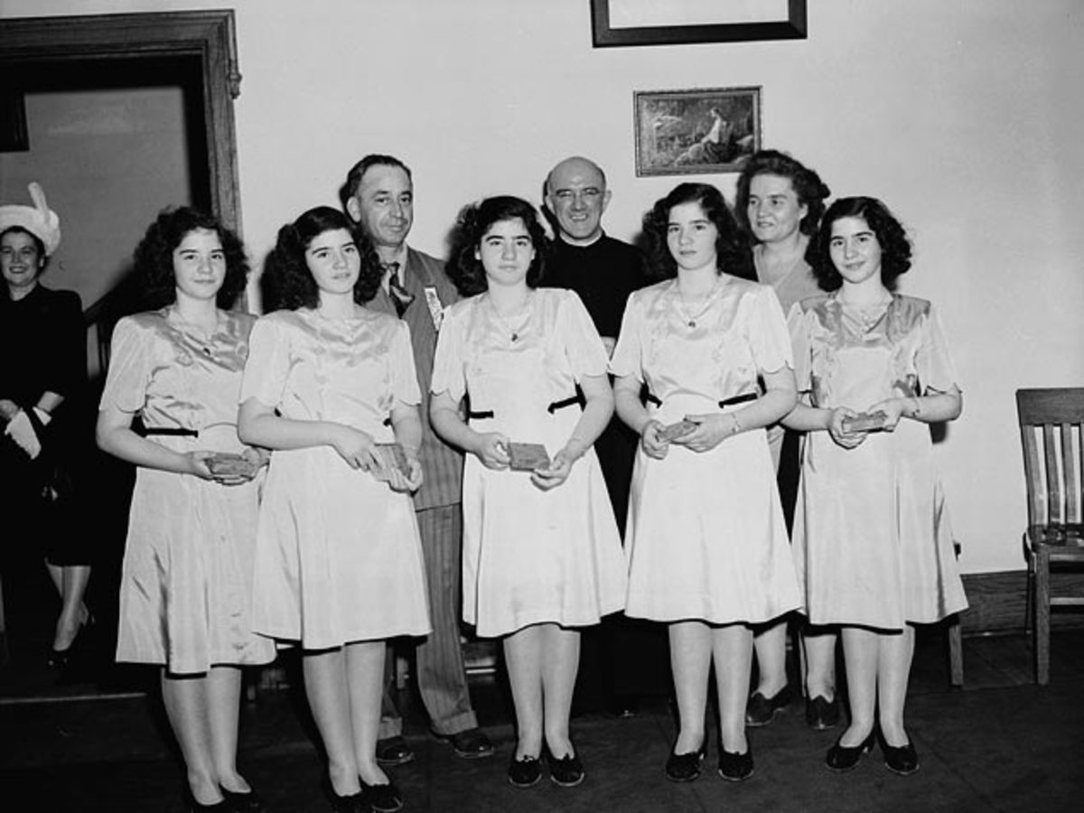 Dionne quintuplets, accompanied by Mrs. Olive Dionne & Frere Gustave Sauve, take part in a program of religious music at Lansdowne park, during the five day Marian Congress which prayed for peace & celebrated the centenary of the Ottawa archdiocese.