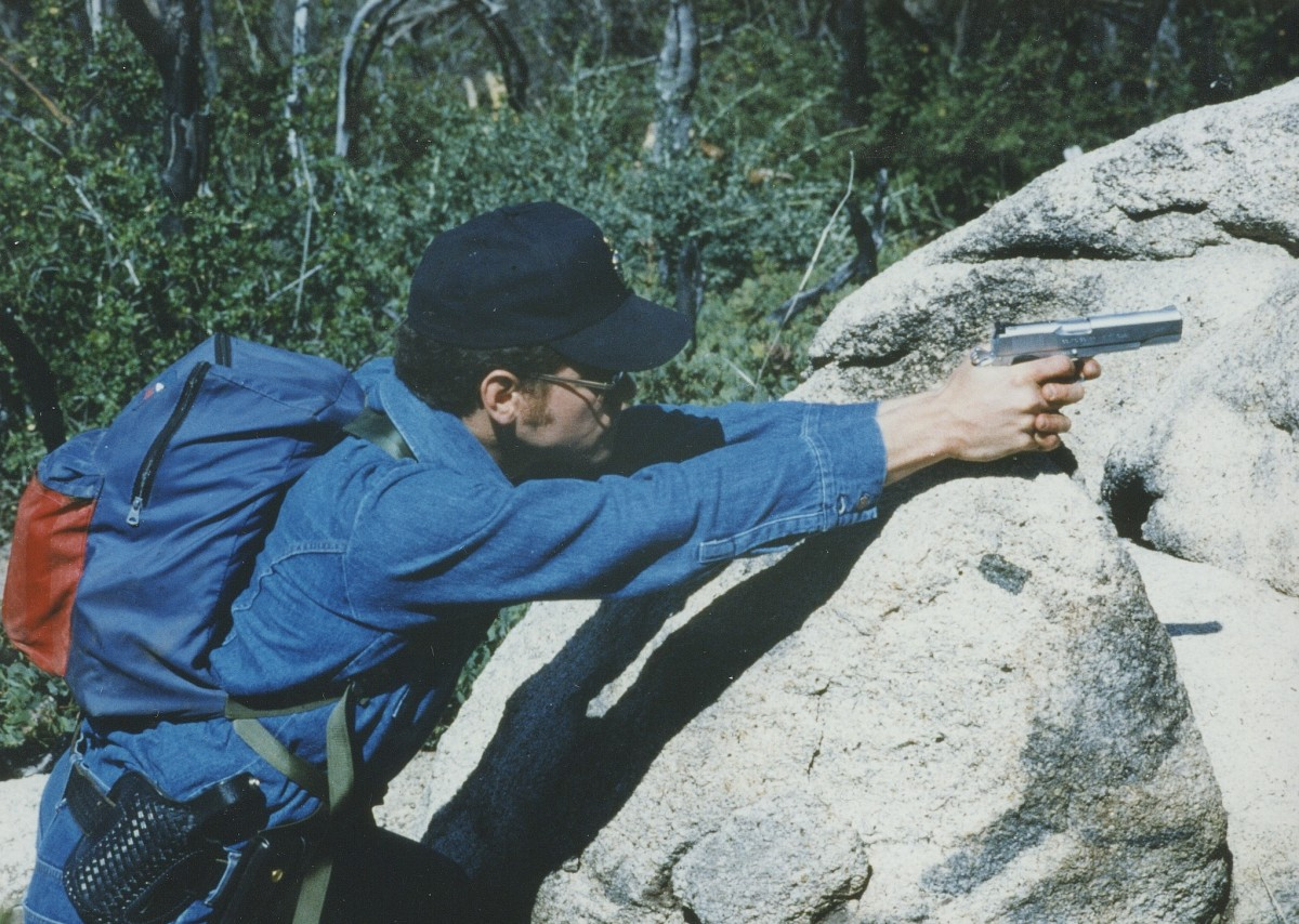 Pest control with the .45 ACP, using a boulder as support for the pistol.