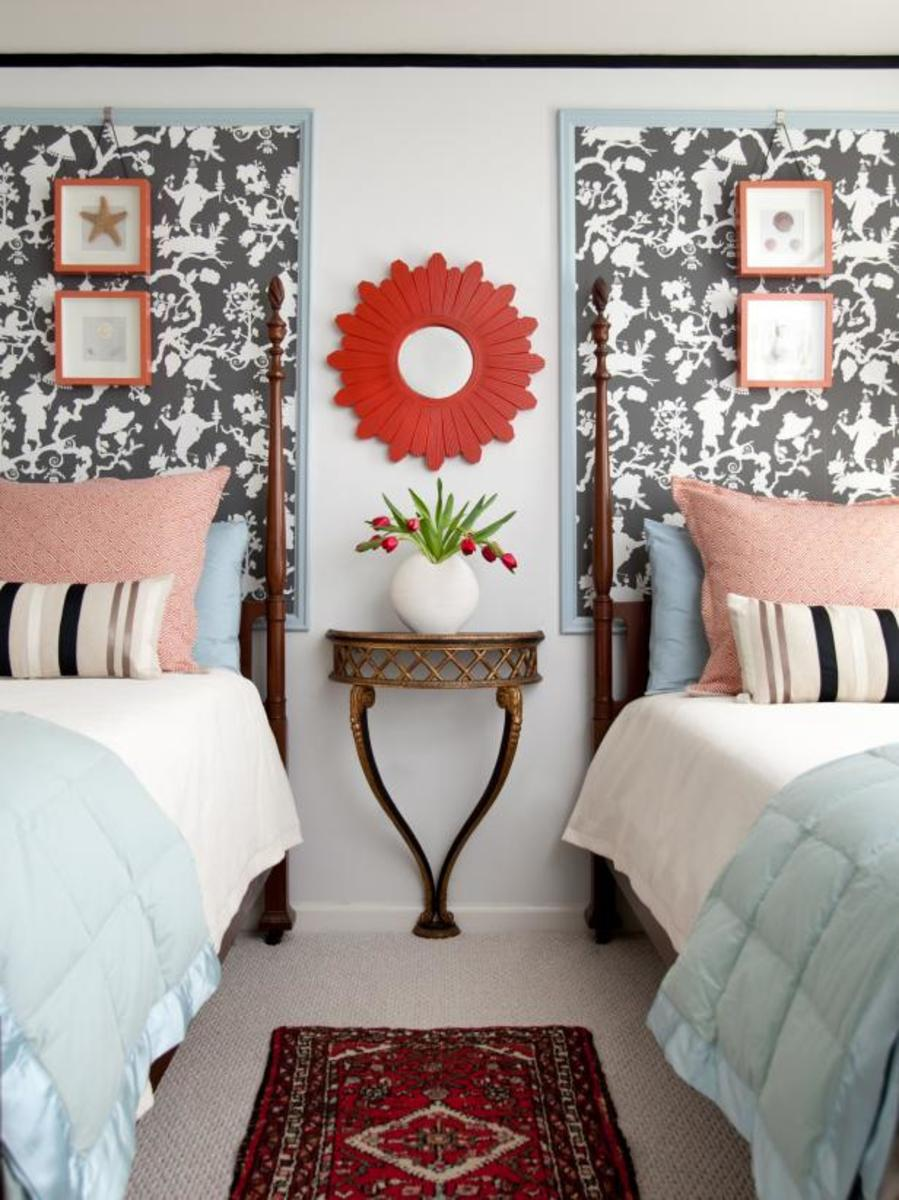 The black and white wallpapers for the twin beds. The trimmed is light blue wood frames.