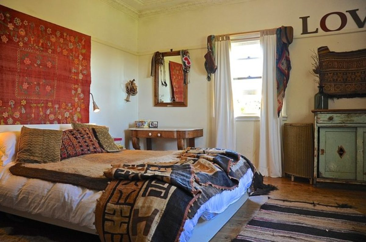 Striking inspired home decor ideas African textile hang above the bed.