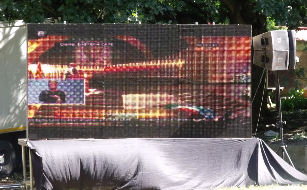 The big screen brought in to allow people at the monument watch the Memorial and Funeral services