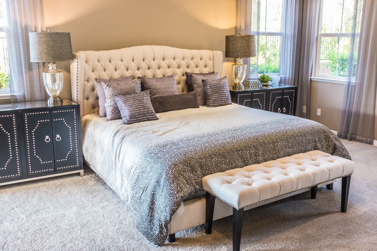 A tufted headboard adds a touch of elegance to any bedroom.