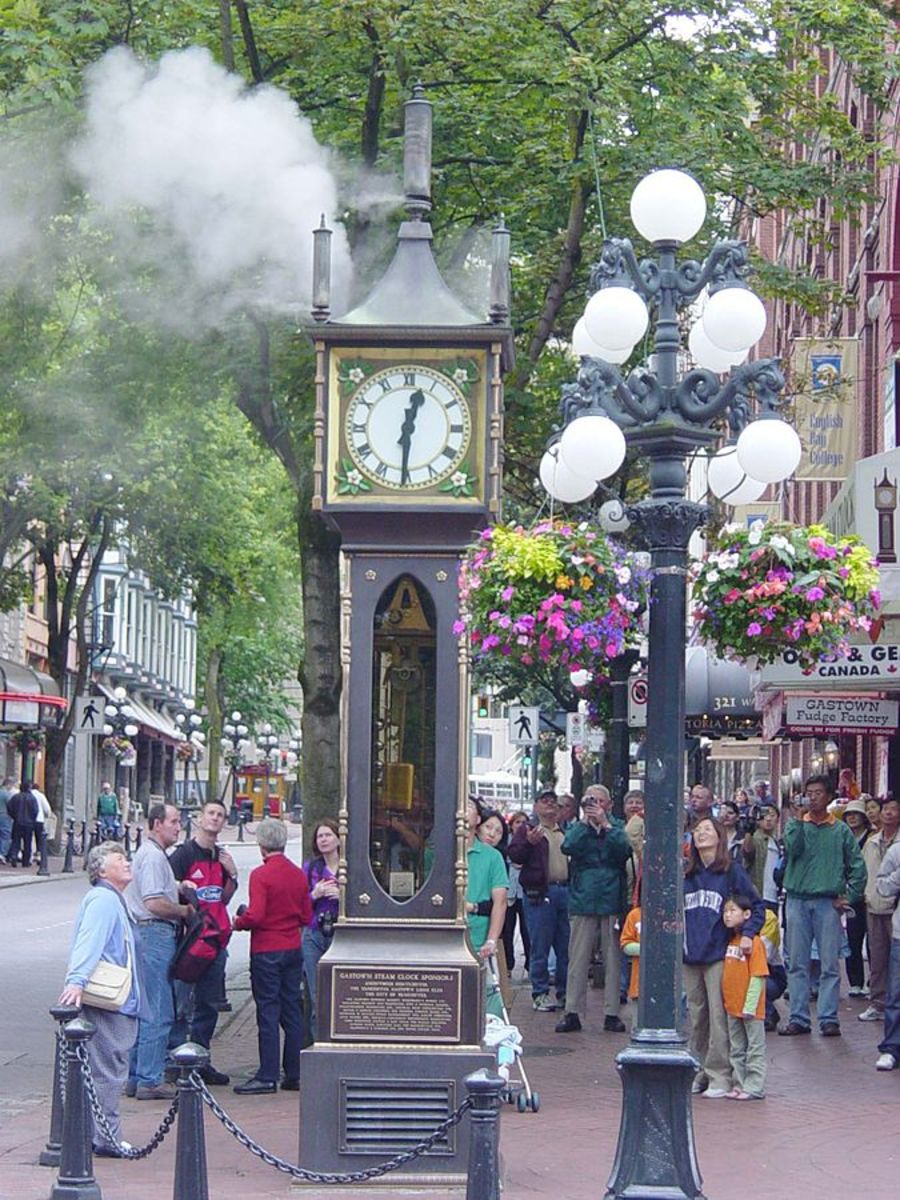 Tourists are entertained by the Gastown, Vancouver, Canada steam clock.