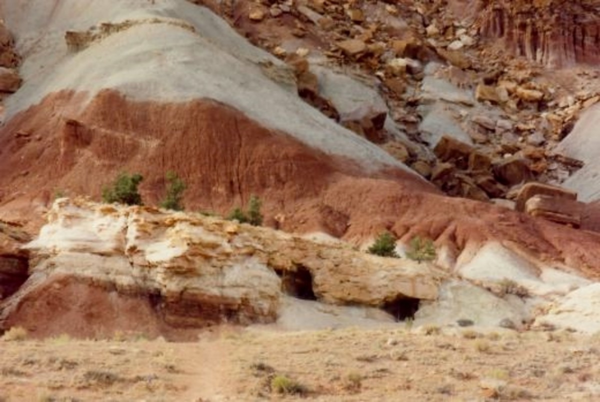 The two dark openings are entrances to uranium mine tunnels in Capitol Reef National Park.