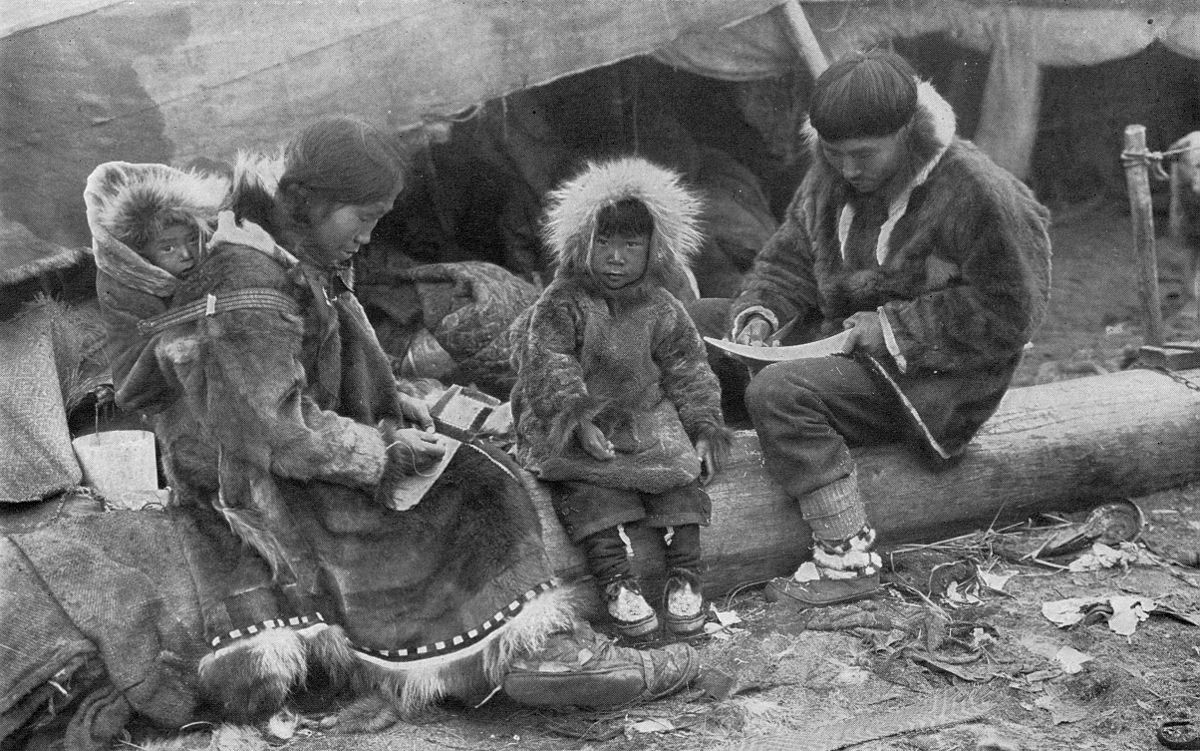 "An inuit family (1917) - ""AN ESKIMO FAMILY. Tenderness and responsibility in their treatment of children is a virtue of the Eskimo which binds them closer to the brotherhood of civilized peoples."""