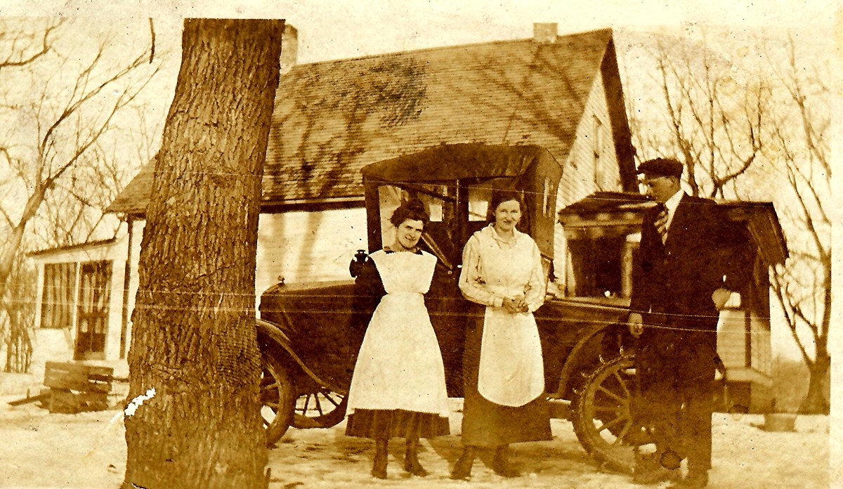 This car might have been similar to the one mentioned in this story.  In the photo are my husband's grandparents plus another person in the middle.