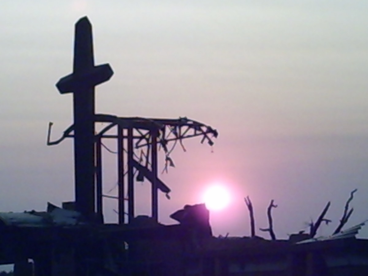 The remnants of St. Mary's Church, with the cross my Grandfather helped build still standing tall above the rubble.