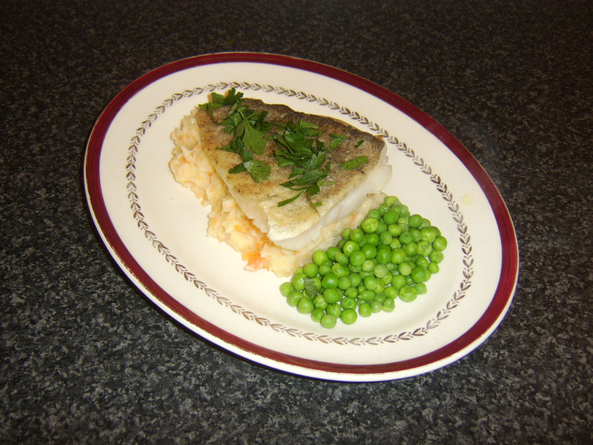 A simply pan fried cod fillet served on a mash of potato, carrot and parsnip