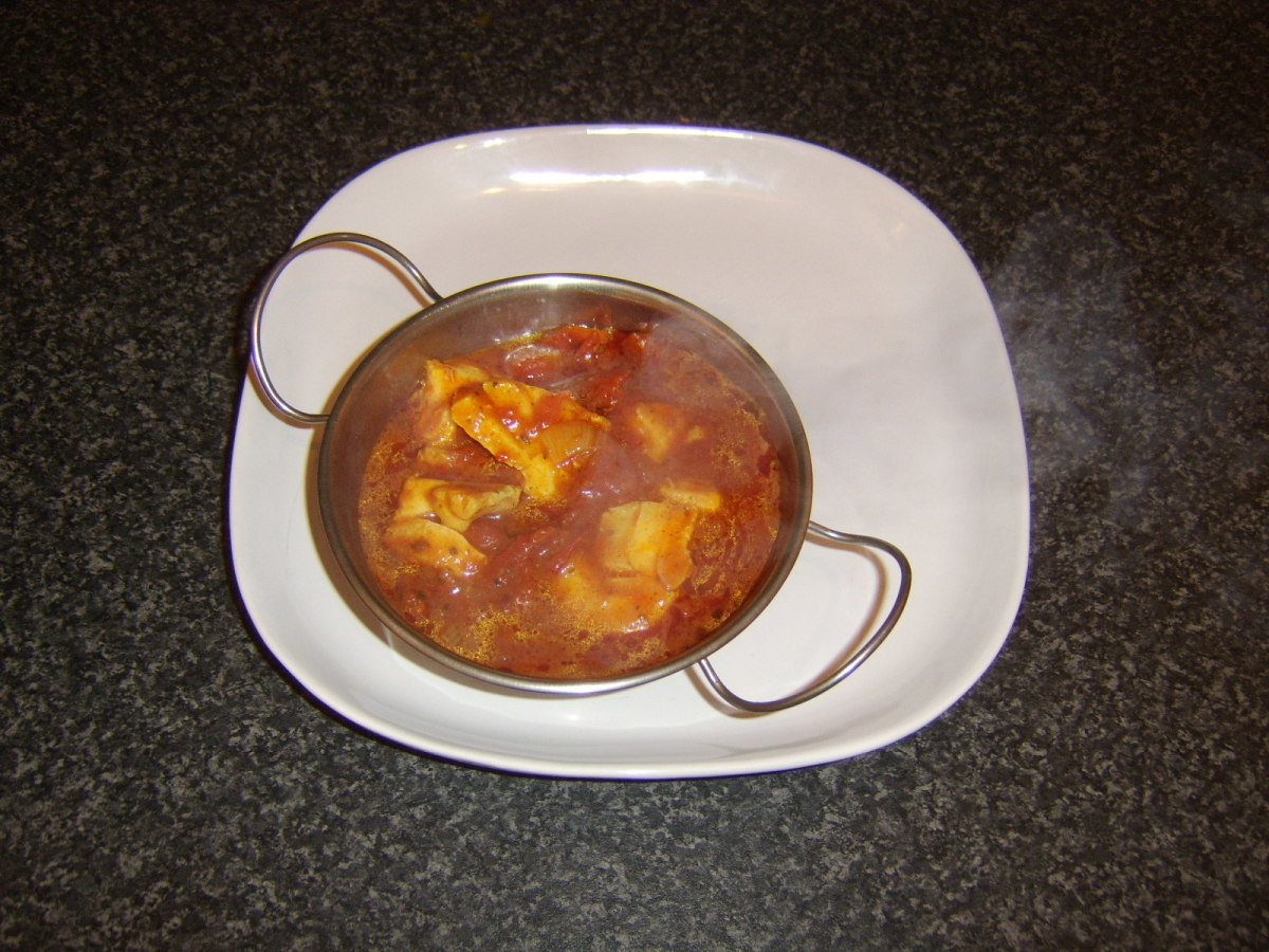 Cod fish curry is served in a heated dish