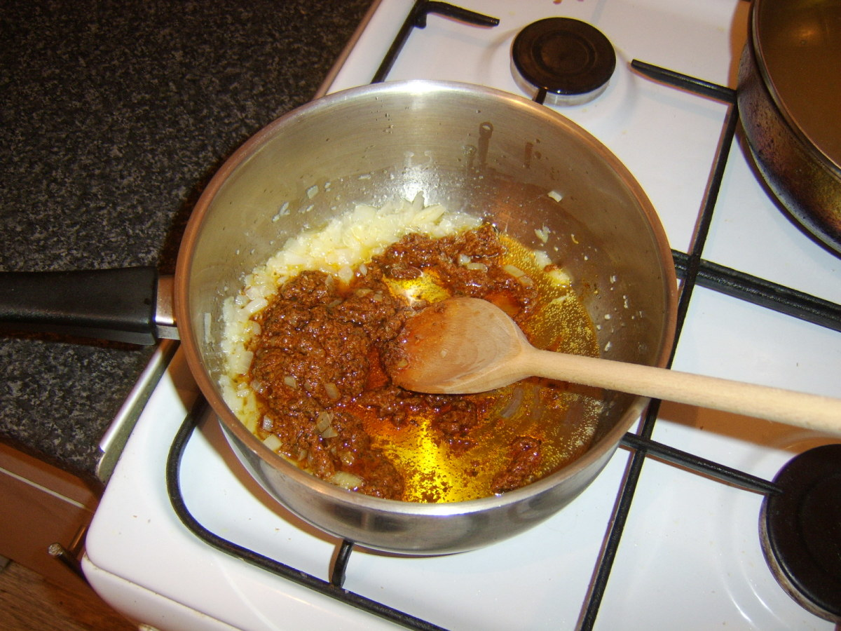 Balti curry paste is added to the softened onion and garlic