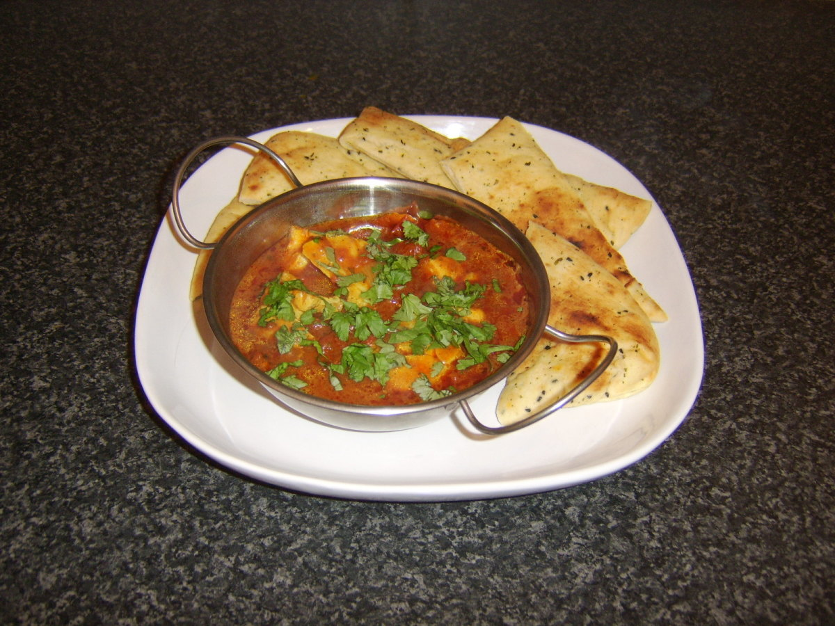 Meaty chunks of cod in a rich but simple curry sauce, served with wedges of naan bread