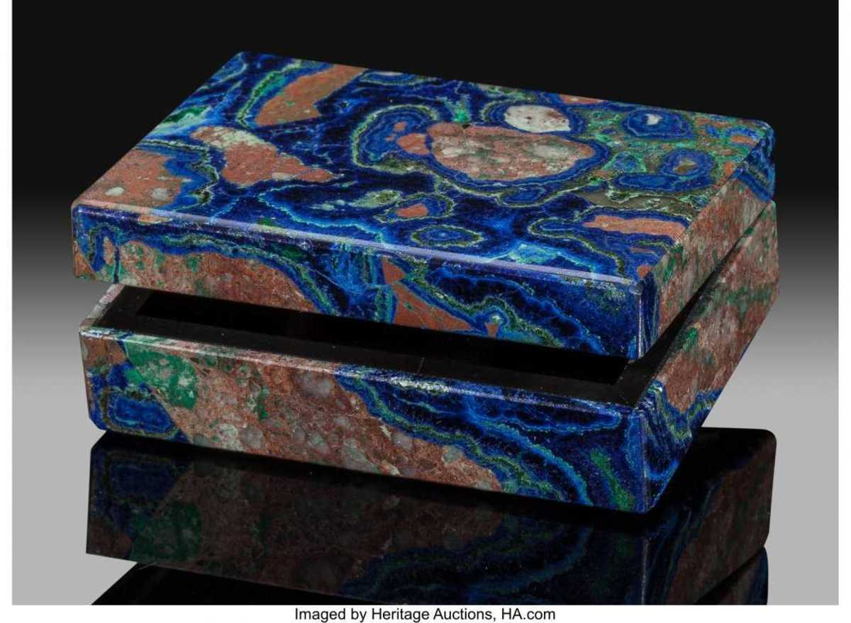 A jewelry box carved from azurite with patterns of cuprite and malachite.