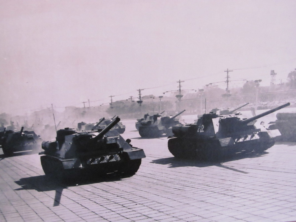 Chinese SU-100s on parade in the 1950s. Wargame Red Dragon's game mechanics make 1940s tank destroyers still relevant on a 1990s battlefield.
