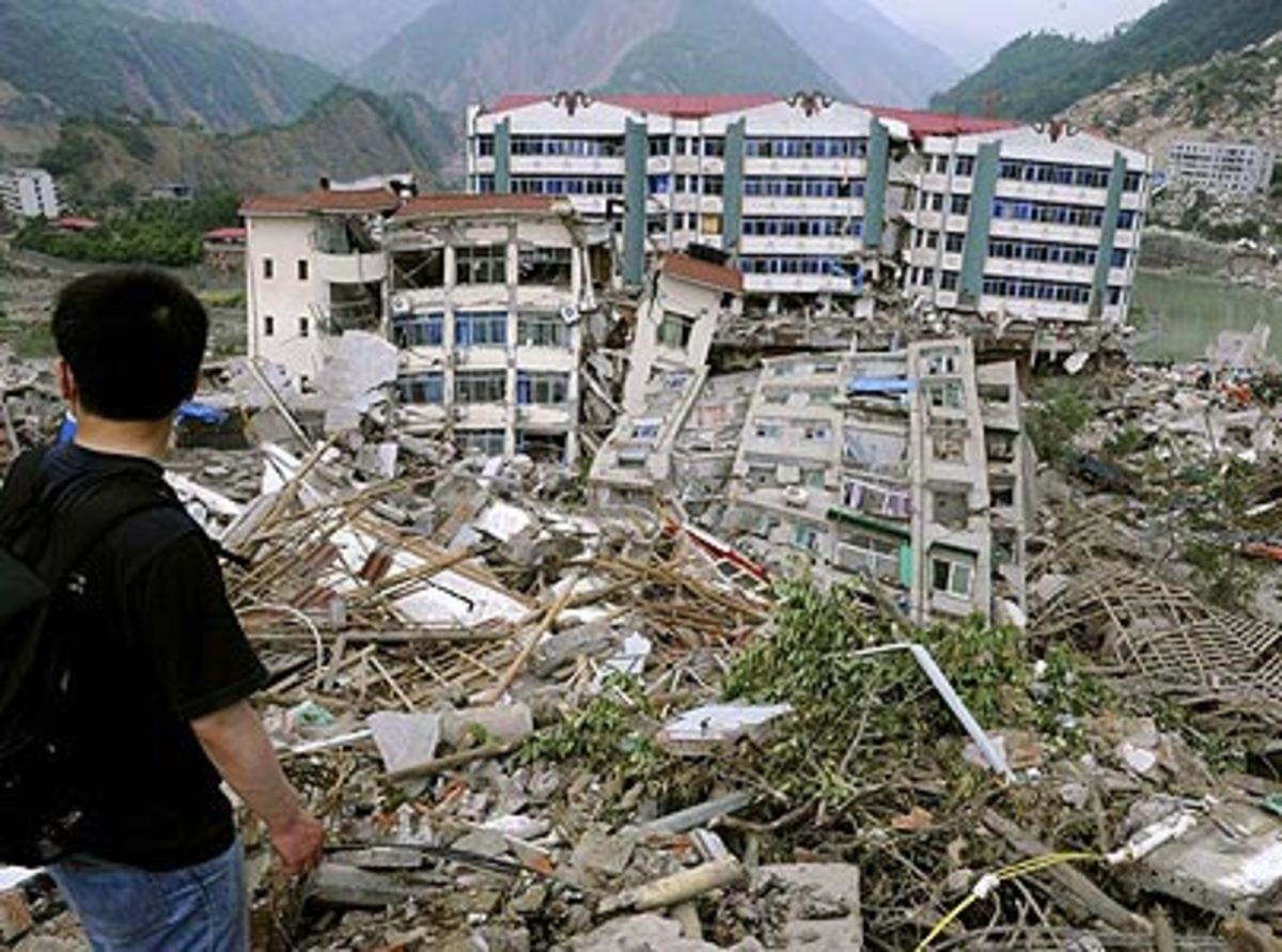 A man looks over apartments destroyed by an earthquake in Beichuan county, Mianyang city, Sichuan province, China, in May, 2008