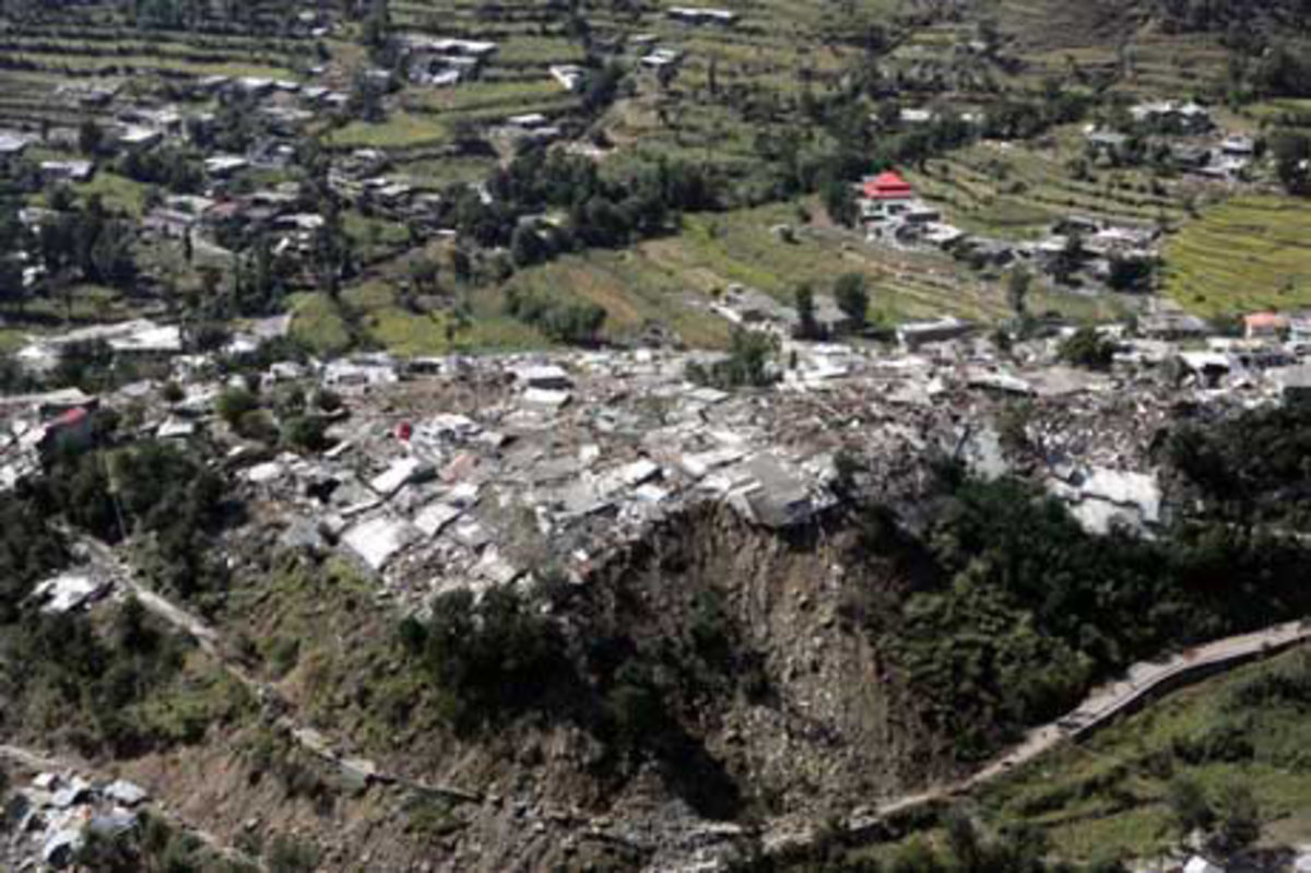 Homes teeter on the edge of a cliff after an earthquake rocked this mountain village
