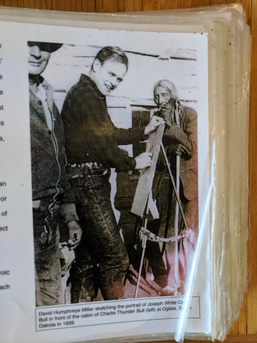 David Humphreys Miller sketching the portrait of Joseph White Co Bull in front of the cabin of Charlie Thunder Bull (to left of Miller) at Oglala, South Dakota in 1939.