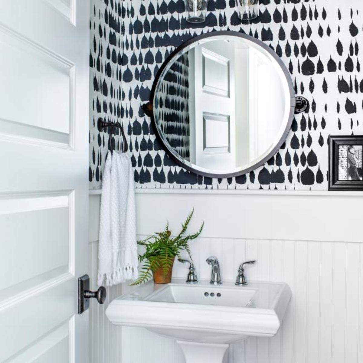 When you've completed all of the upgrades, you can begin planning the interior of your powder room. The black and white color scheme is timeless and works well in every print or pattern.