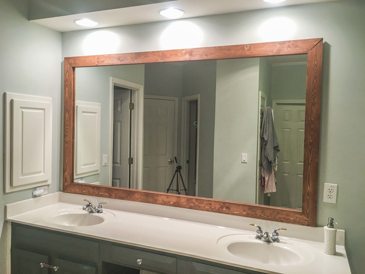That's why we added a special stained wood frame to our mirror.