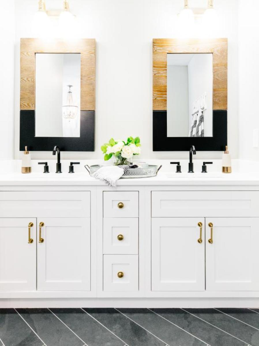 The bathroom black, gold, and wood highlights.