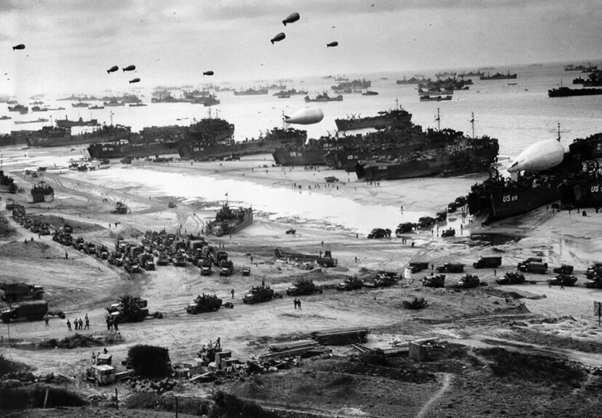 Barrage balloons put up by the 320th over a D-Day beach