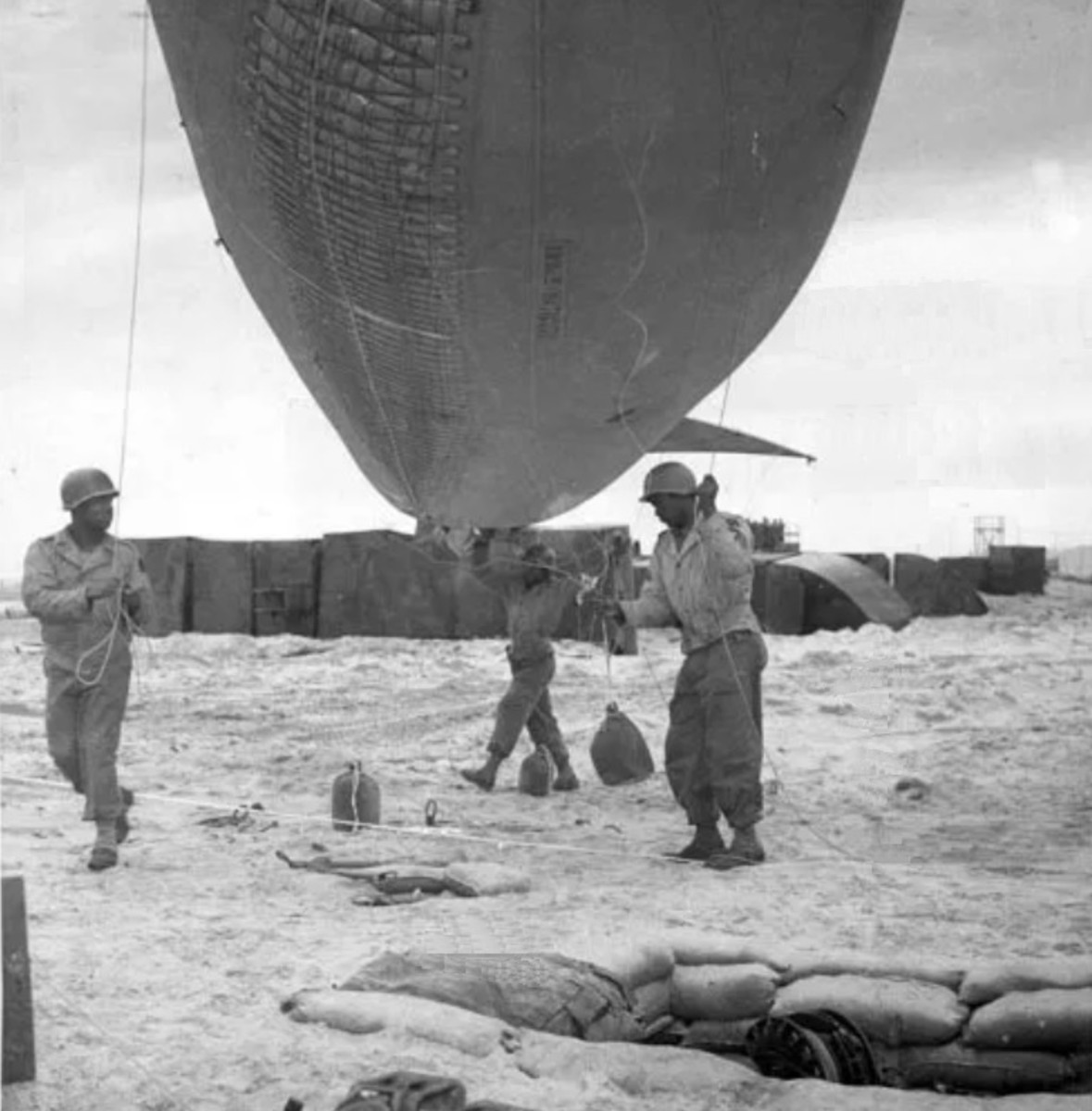 Soldiers of the 320th launch a barrage balloon on Omaha Beach on D-Day.