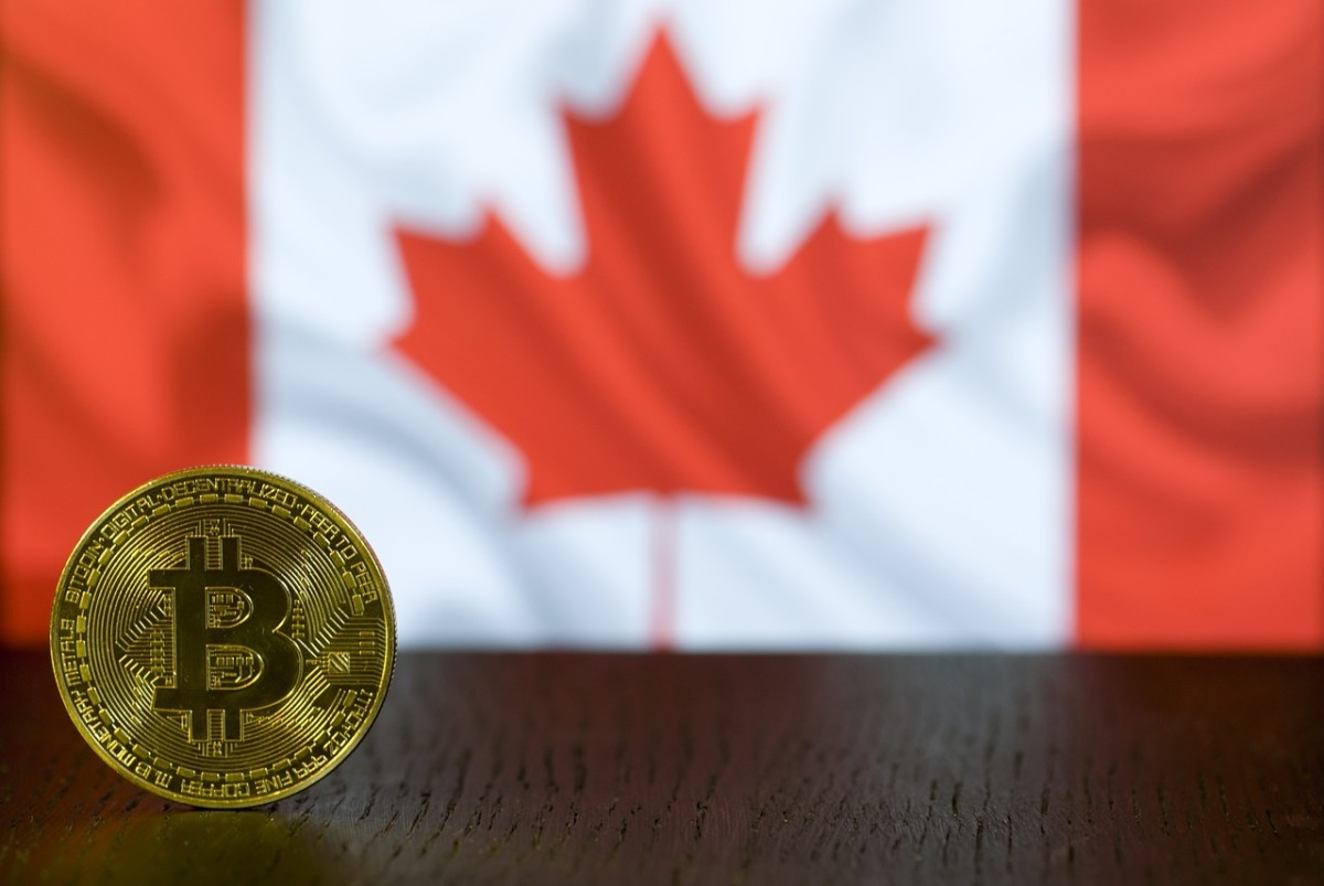 Bitcoin in foreground with Canadian flag in background