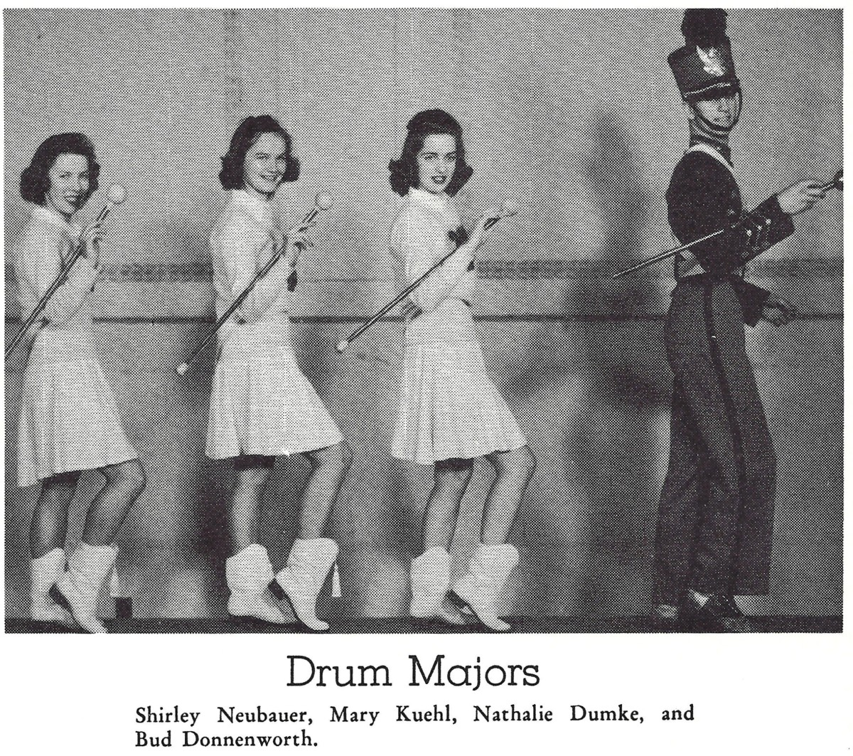 The band and these drum majors would have been busy at many of the athletic events.