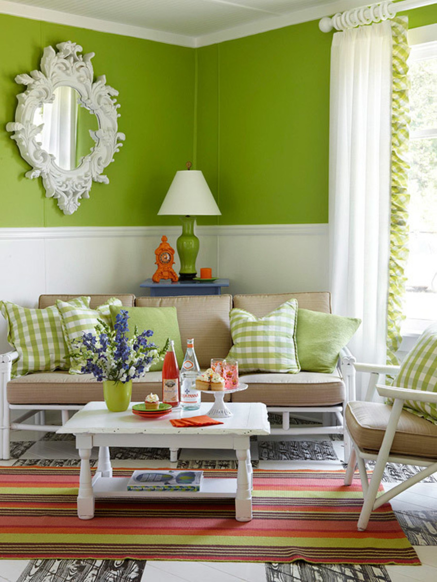 Here, a apple green sofa and bright pillows pack a punch. The rug stripe  orange, brown, green and pinks adds a feminine touch to the classic furnishings.