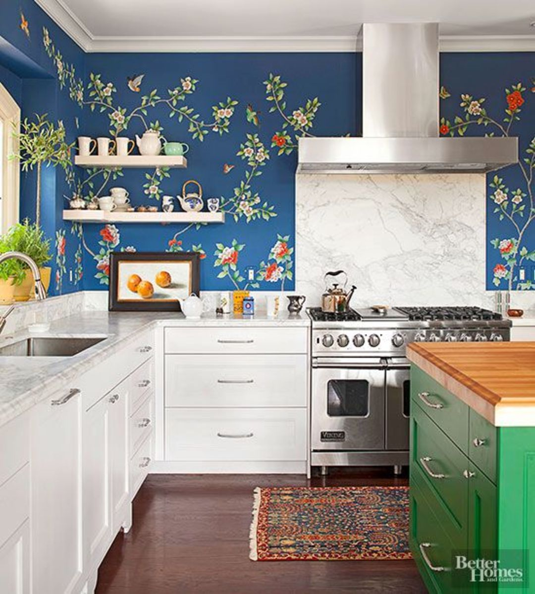 Make a statement with garden-themed kitchen wallpaper designs. The light  blue backdrop is traditional white cabinetry, granite countertops and open upper shelves.